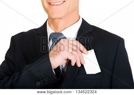 Businessman taking a blank card from pocket