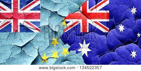 Tuvalu flag with Australia flag on a grunge cracked wall