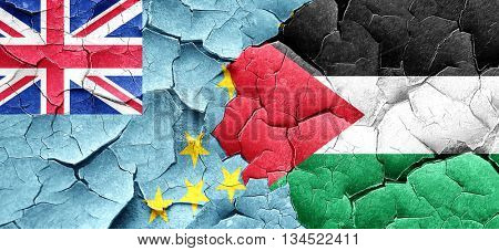 Tuvalu flag with Palestine flag on a grunge cracked wall