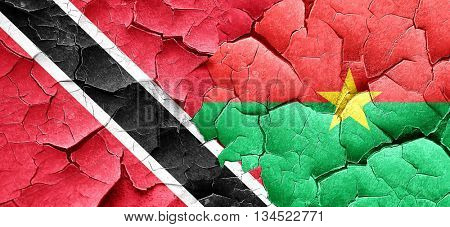 Trinidad and tobago flag with Burkina Faso flag on a grunge crac