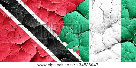 Trinidad and tobago flag with Nigeria flag on a grunge cracked w