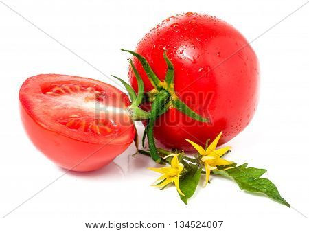 tomatoes and half with leaves and flower and water drops isolated on white background