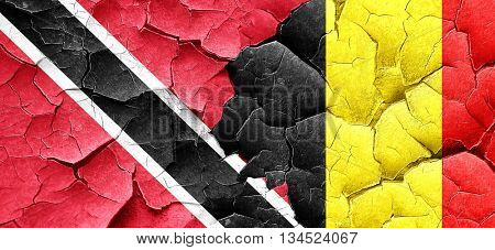 Trinidad and tobago flag with Belgium flag on a grunge cracked w