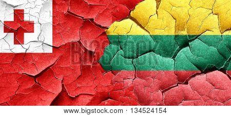 Tonga flag with Lithuania flag on a grunge cracked wall