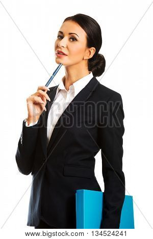 Thoughtful businesswoman holding a pen