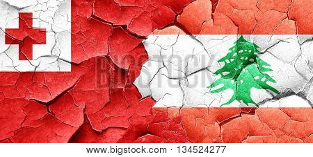 Tonga flag with Lebanon flag on a grunge cracked wall