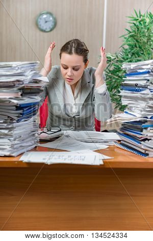 Woman under stress from excessive paper work