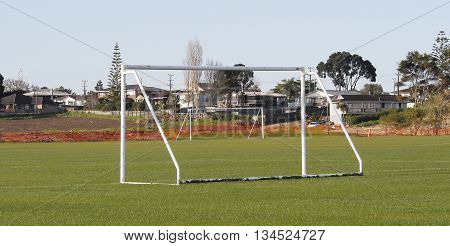 Soccer goal posts of two fields waiting for players