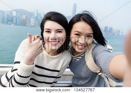 Woman taking selfie image together