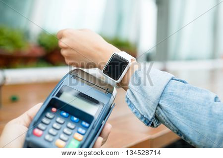Customer paying through smart watch