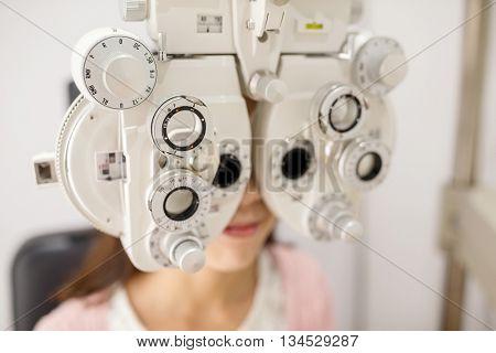 Woman doing eye test