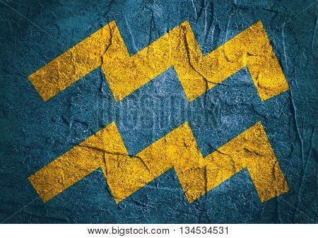 Water bearer astrology sign. Yellow astrological symbol on concrete textured backdrop