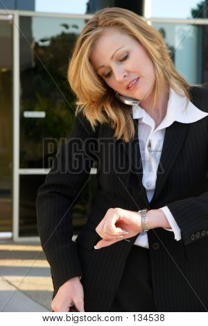 Business Woman On The Phone Checking Watch