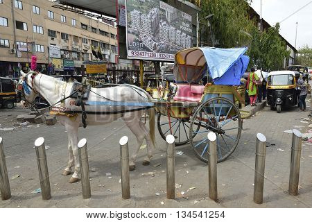 Bombay, India - June 10, 2016: Horse Cart and Auto rickshaw outside Central Railways Kalyan Junction, Bombay, Maharashtra