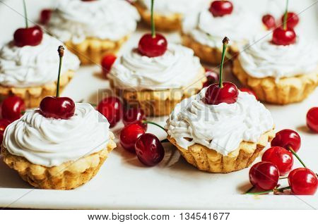 Beautiful Chocolate Cupcakes With White Protein Cream And Cherry