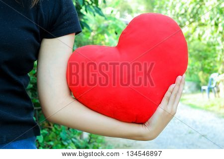 Red heart in woman hand.love concept .