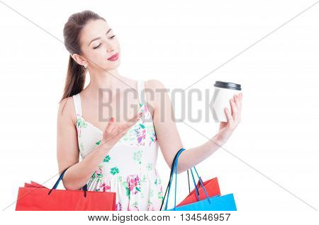 Attractive Lady Shopper Showing And Looking At A Paper Mug