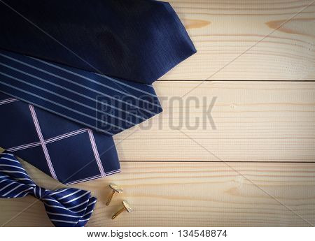 Neckties And Bow And Cufflinks On The Wooden Table