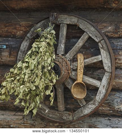 bunch of green birch twigs and scoop on vintage wheel close up