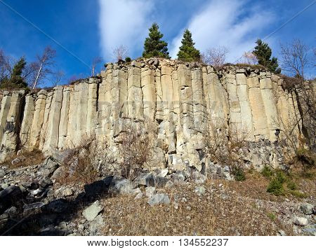 Image of the old basalt quarry in The Ore Mountains - basalt columnar jointing
