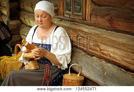 KIZHI RUSSIA - AUG 07 2015: Women in traditional russian costume in Historico-architectural museum Kizhi on Kizhi island Karelia Russia.