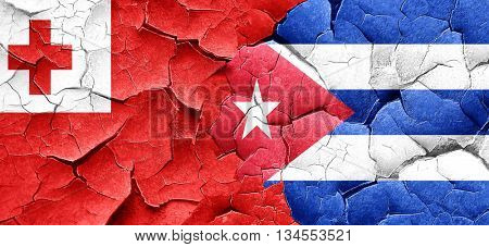 Tonga flag with cuba flag on a grunge cracked wall