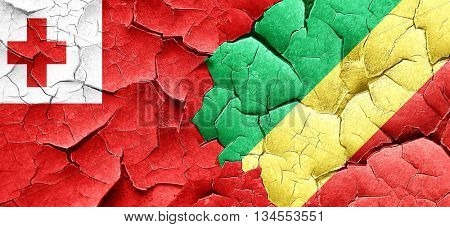 Tonga flag with congo flag on a grunge cracked wall