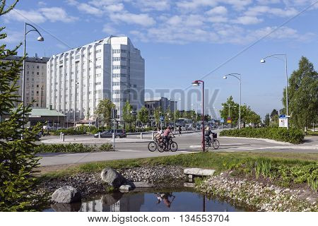 UMEA, SWEDEN ON JUNE 02. View of the Entry North to the Region Hospital, NUS in morning traffic on June 02, 2016 in Umea, Sweden. Unidentified people in the traffic and in the park. Editorial use.