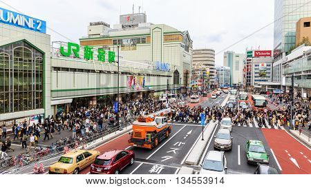 Tokyo Japan - April 9 2016: People for street crossing at Shinjuku JR Railway Station. Shinjuku Station is one of the busiest station in Tokyo. Japan.