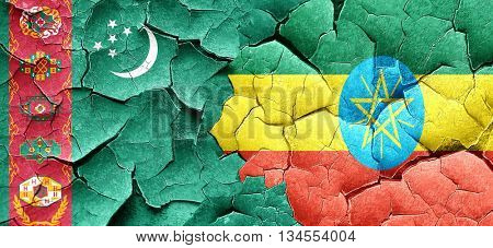 Turkmenistan flag with Ethiopia flag on a grunge cracked wall