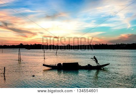 QUANG BINH, Vietnam, September 21, 2015 man rowing on river Quang Binh Province, Vietnam, in the afternoon