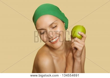 adult girl in a green scarf with apple