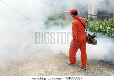 Workers Are Fogging For Dengue Control. Mosquito Borne Diseases Of Zika Virus.