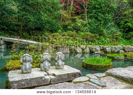 Three wise monkeys. Hear no evil, see no evil, speak no evil in a Japanese garden, Japan.