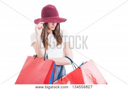 Attractive Shopaholic Holding Her Hat Acting Mysterious Or Hiding