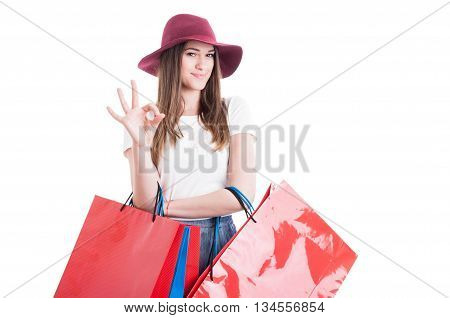 Happy Shopaholic Showing Ok Symbol And Carrying Shopping Bags