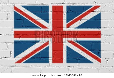 Great Britain flag on a white brick wall.