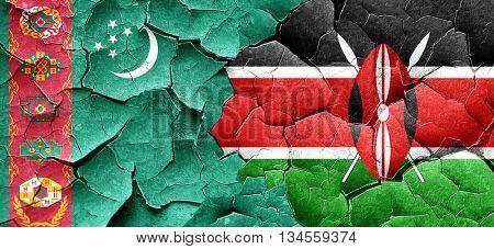 Turkmenistan flag with Kenya flag on a grunge cracked wall
