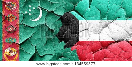 Turkmenistan flag with Kuwait flag on a grunge cracked wall
