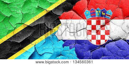 Tanzanian flag with Croatia flag on a grunge cracked wall
