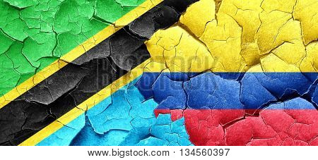 Tanzanian flag with Colombia flag on a grunge cracked wall