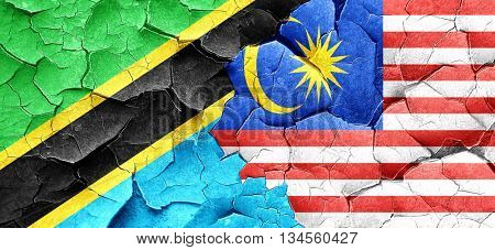 Tanzanian flag with Malaysia flag on a grunge cracked wall