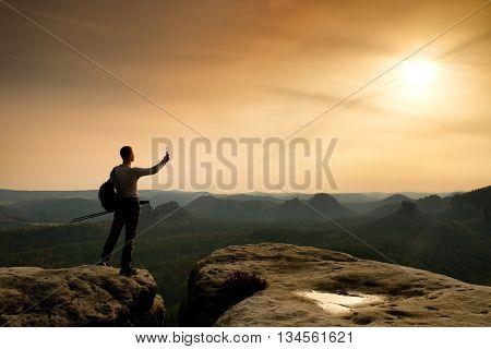 Sharp Silhouette Of Active Man On Mountain Peak