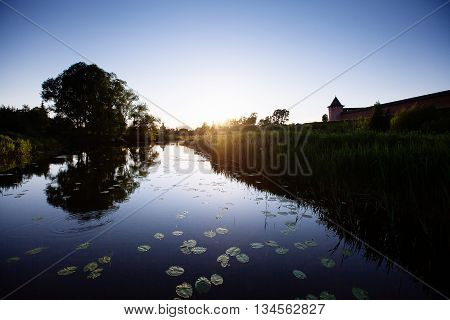 Sunset On The River. The Evening Was Very Quiet And Warm. The Sun Slowly Hid Behind The Horizon And