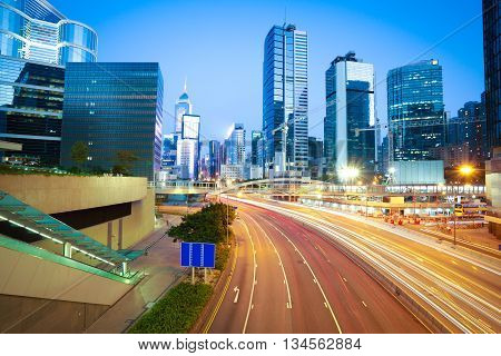 Hong Kong Of City Car With Light Trails Of Modern Urban Buildings