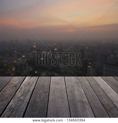 Empty old wood floor with blurred aerial view of cityscape on warm light sundown for your product display montage
