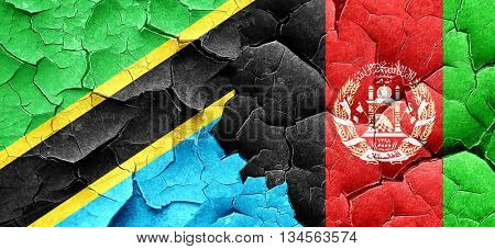 Tanzanian flag with afghanistan flag on a grunge cracked wall