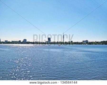 Hamburg lake Aussenalster with sailing boats - skyline of Hamburg city