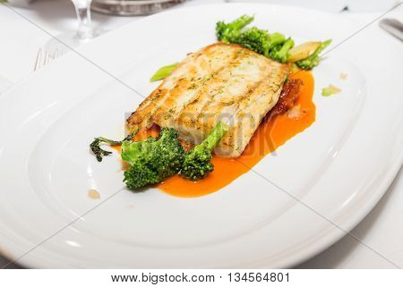 Baked Tilapia and Broccoli in a sauce