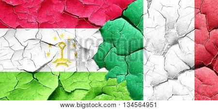 Tajikistan flag with Italy flag on a grunge cracked wall